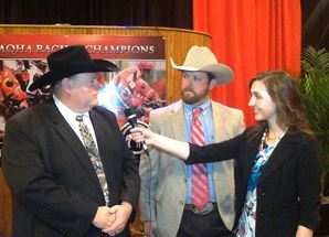 AQHA intern Annise Montplaisir interviews champion owners at the 2014 AQHA Racing Champions ceremony. Journal photo.