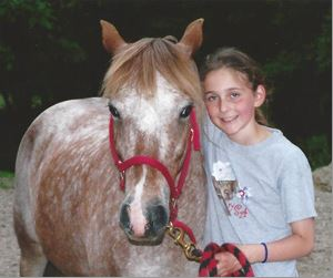 Annise with her first pony, Ginger. Photo courtesy of Annette Montplaisir