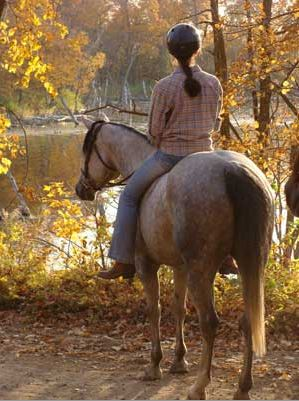 Annise and her horse Misty enjoy a trail ride. Photo by Annette Montplaisir